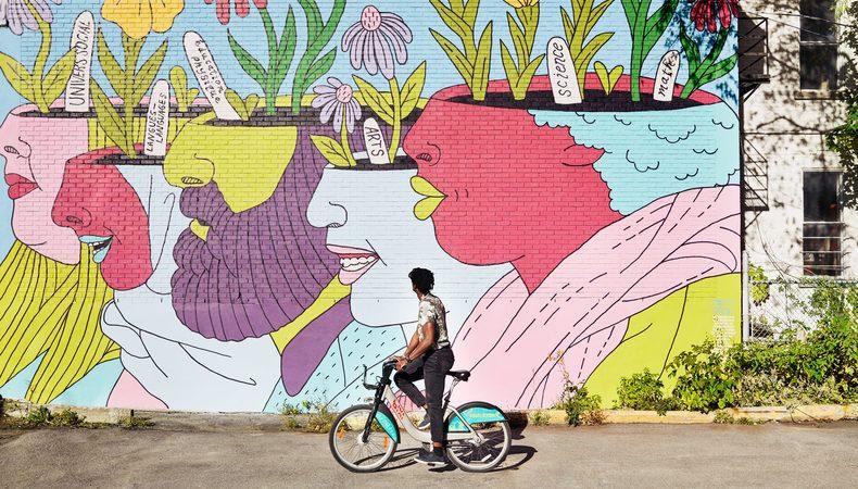 Biking next to art.