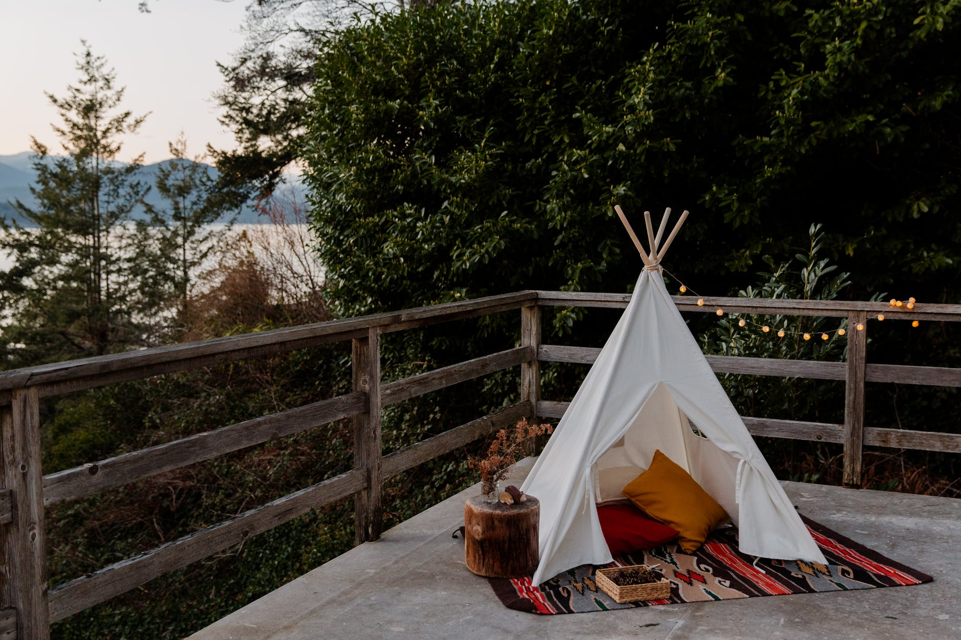 Boho decorated hideaway tent with ample floor seating.